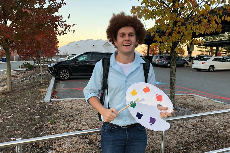 Myle+Larsen%2C+dressed+as+Bob+Ross%2C+paints+tranquility+over+WHS.