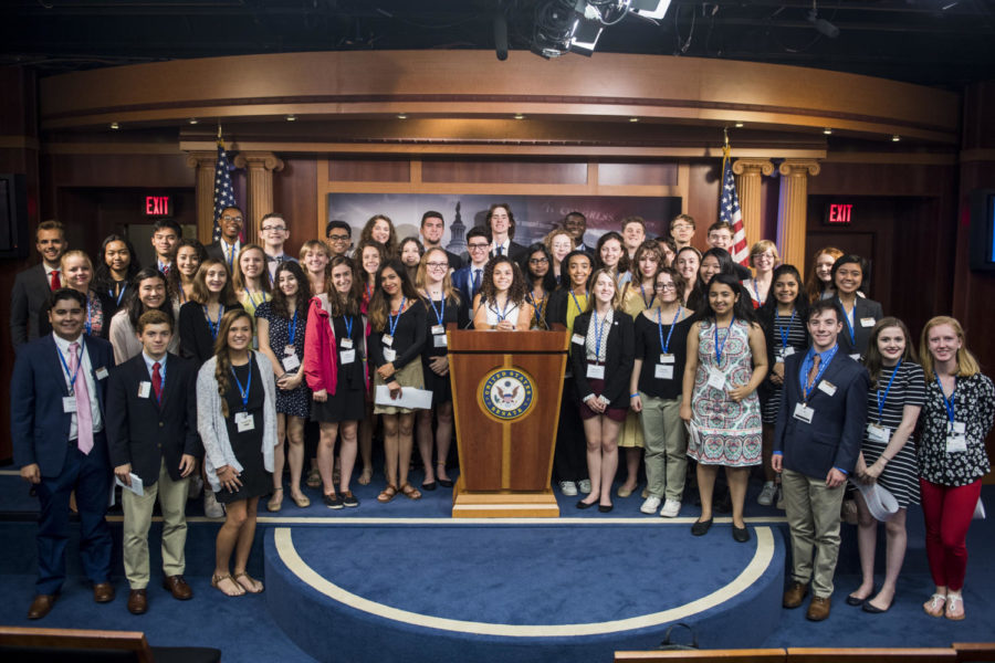 The free spirits pose for a picture at the Senate Radio and Television Correspondents Gallery.