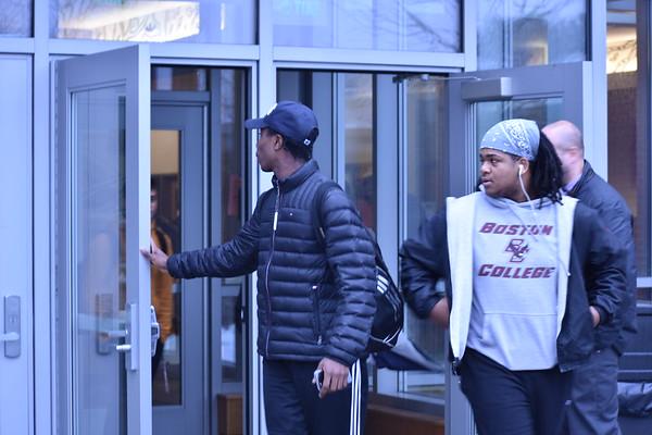 Junior+Jaden+Brewington+holds+the+door+open+for+students+walking+out.