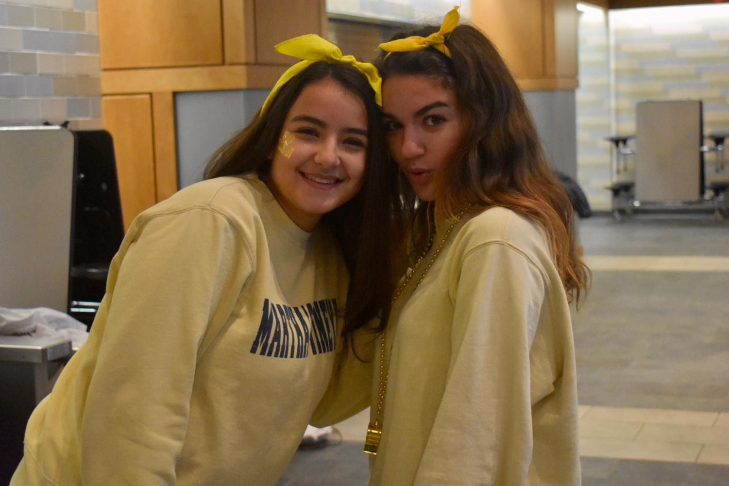 Juniors+Fatma+Sayeh+and+Christina+Taxiarchis+dress+in+yellow+to+show+team+spirit.