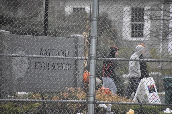 Students+walk+past+the+Wayland+High+School+sign.