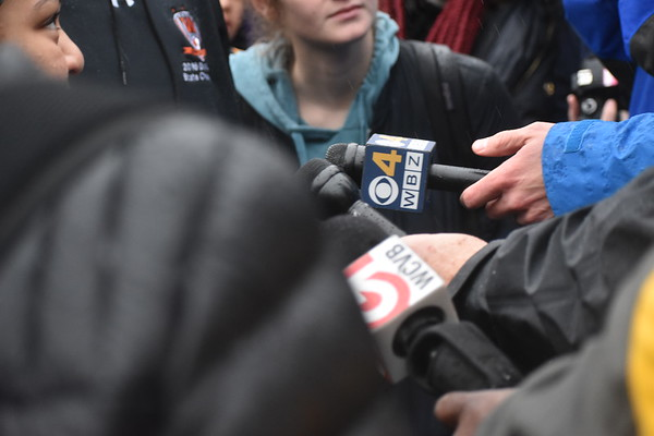 Several+news+stations+hold+microphones+to+the+students.