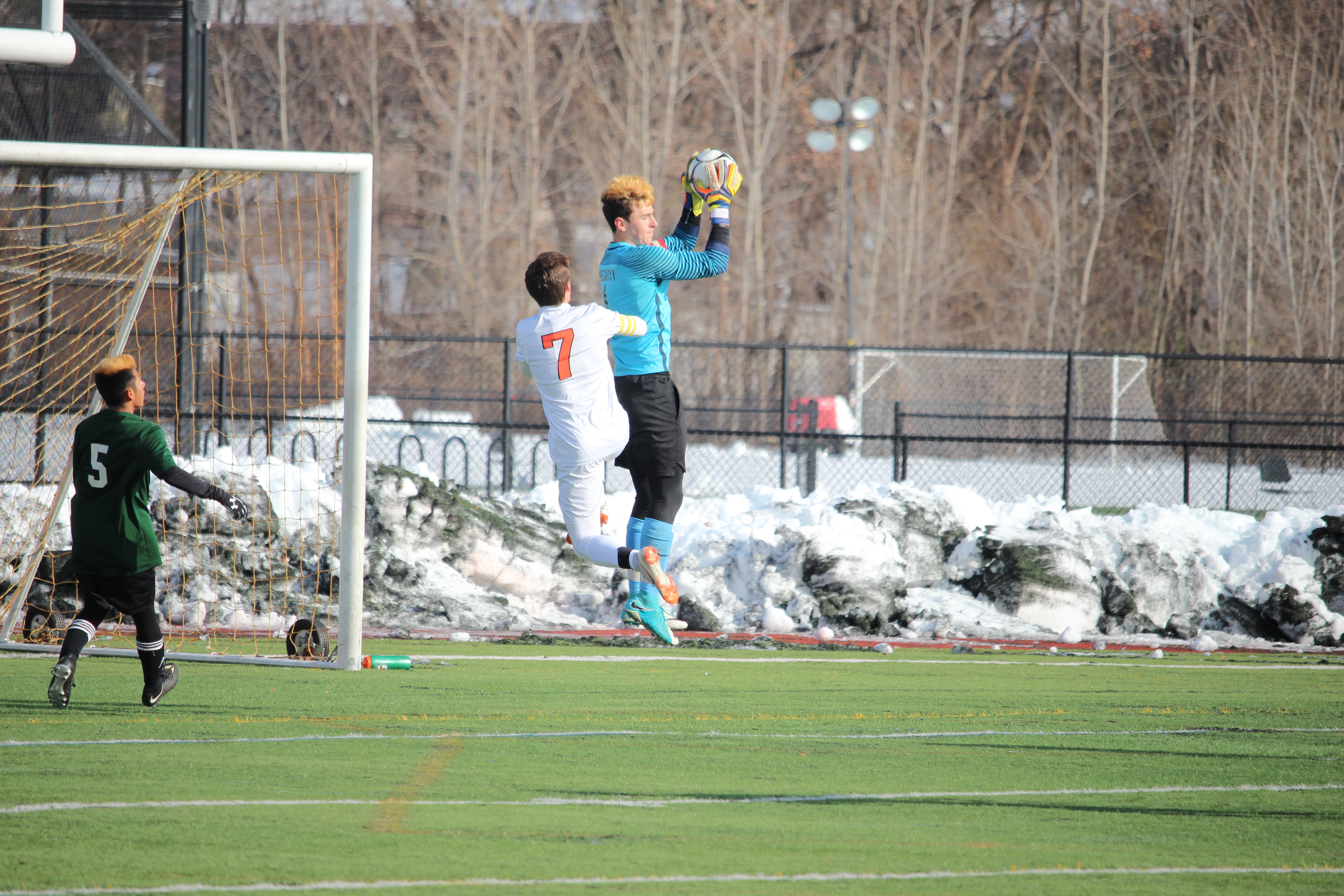 Senior+captain+Andrew+D%27Amico+jumps+to+challenge+the+Nipmuc+goalie.