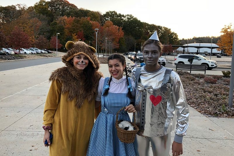 Seniors Emily Hanania, Annie Clarke and Emma Diianni dress as the Lion, Dorothy and the Tin Man on Halloween.