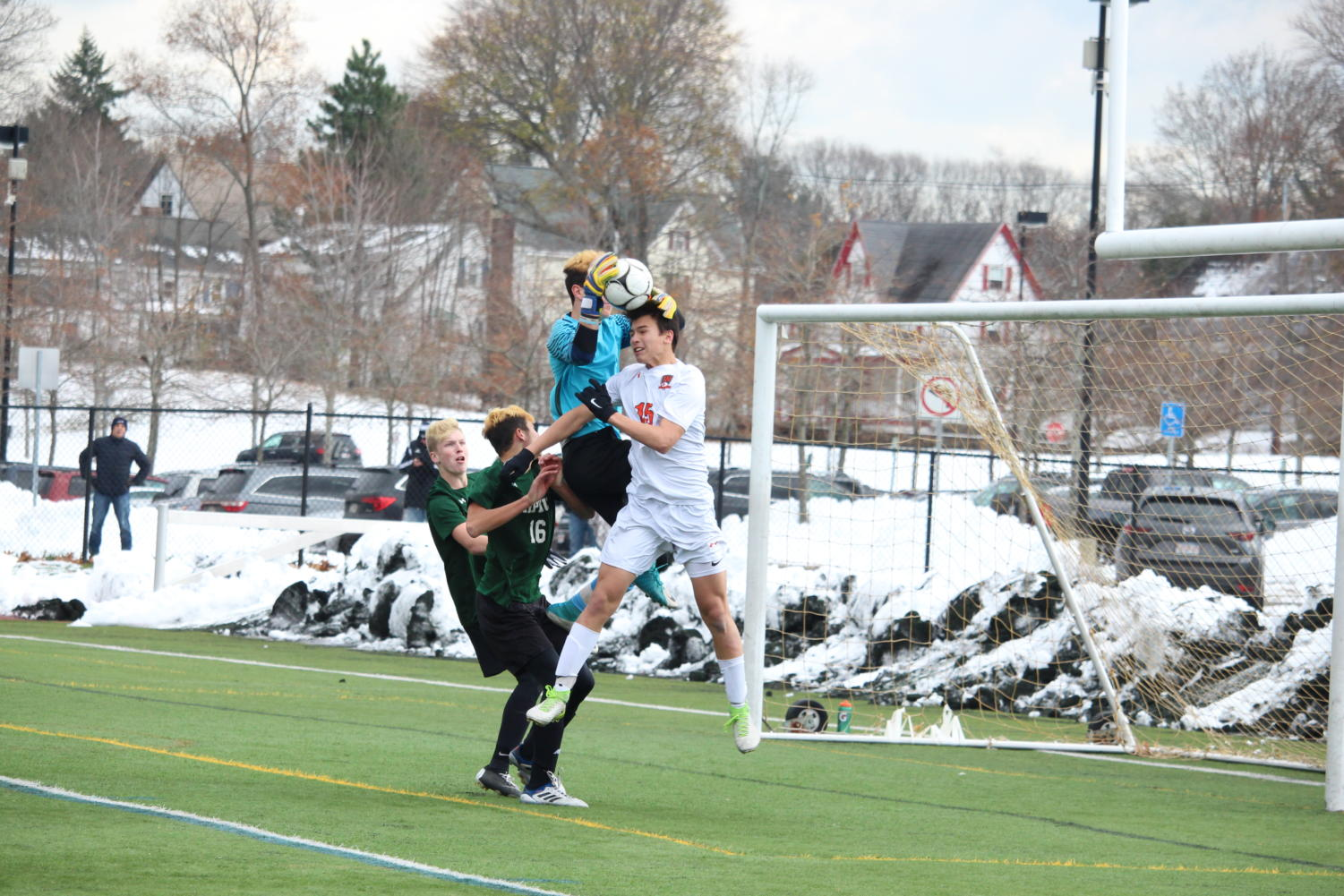 Tyska+attempts+to+head+the+ball+into+the+goal%2C+but+Nipmuc+goalie+Colby+Hegarty+snatches+the+ball+from+the+air.