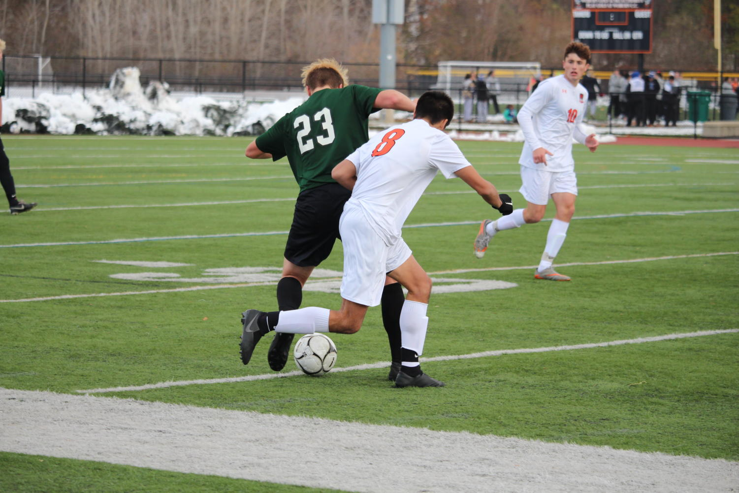Wong+pursues+a+Nipmuc+player+as+he+tries+to+get+the+ball.
