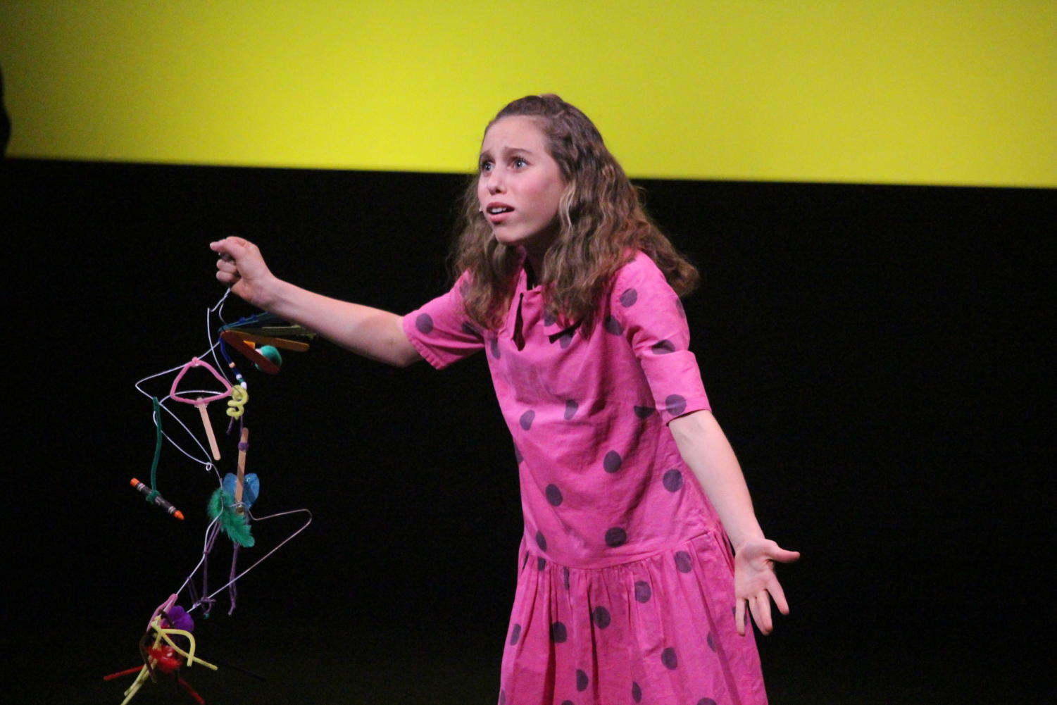 """Freshman Sammy Janoff, December's Artist of the Month, sings to the audience. """"As a kid, I did a lot of community theatre and it was always an interest of mine because it combined the three things I really enjoyed doing: acting, singing, and dancing,"""" Janoff said."""