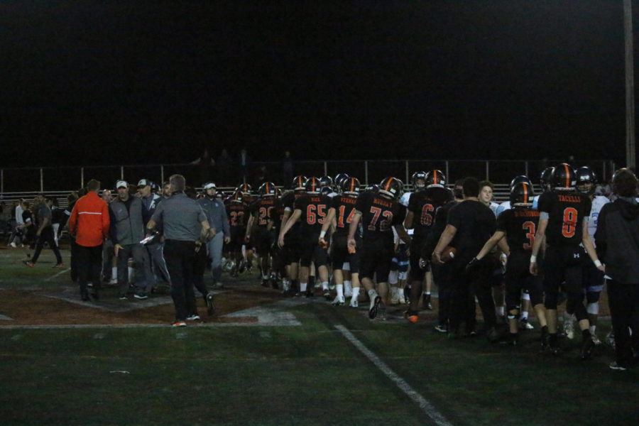 Wayland lines up to shake hands with Dracut after the game.