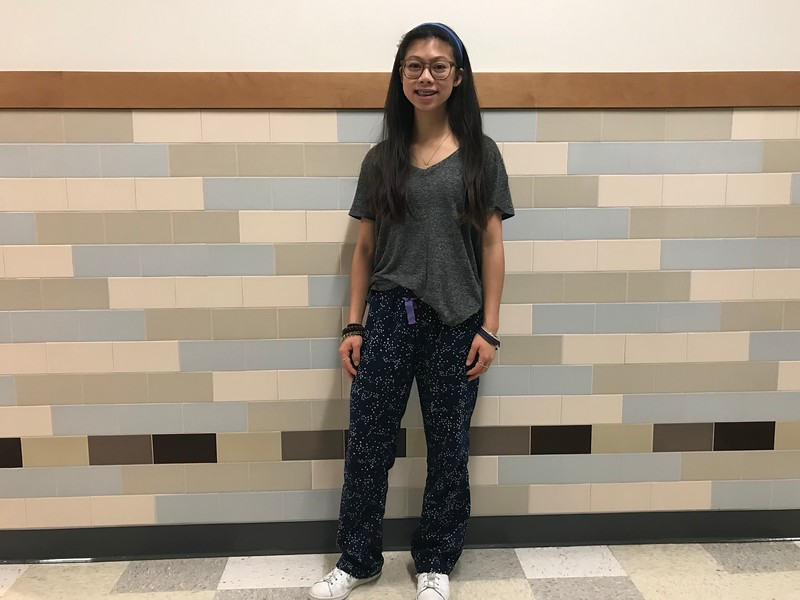 "Freshman Emily Chau dresses in pajamas from American Eagle for the school wide psych with Adidas sneakers. ""Don't try to go with something because it's a trend. Start with something you're comfortable with, and then from there you can kind of play around with it,"" Chau said."