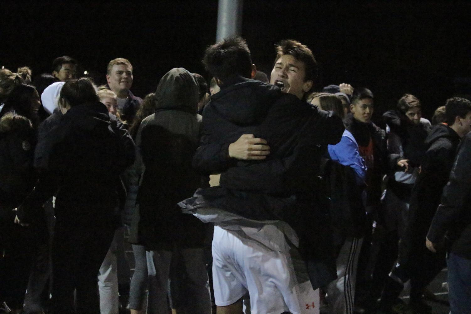 Tyska+and+Wong+hug+after+the+last+goaal+is+scored+in+the+shootout.+
