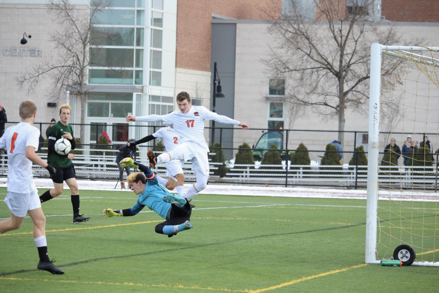 Dretler+jumps+over+the+Nipmuc+keeper+in+an+attempt+to+score.