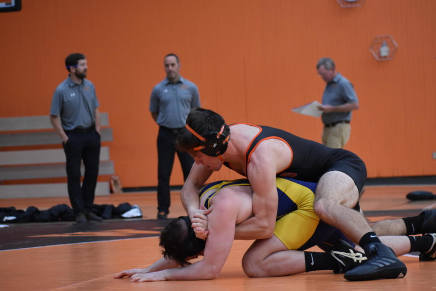 "Senior Michael German power half-Nelsons his Lexington opponent. ""I would say it is important to start the season on a high note to keep the good vibes [flowing] in the [wrestling] room. Especially with a lot of young guys and a nice team win to finish off the day, people are starting to get a taste of what Wayland wrestling is all about. Hopefully the 'good life experience' is beginning to become a part of our new wrestlers' lives,"" German said."