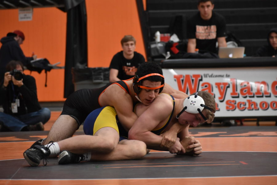 Junior Marcos Pereira holds down his Lexington opponent.