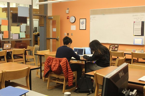 Students study in the academic center. The academic center works to connect students with peer tutors and teachers.