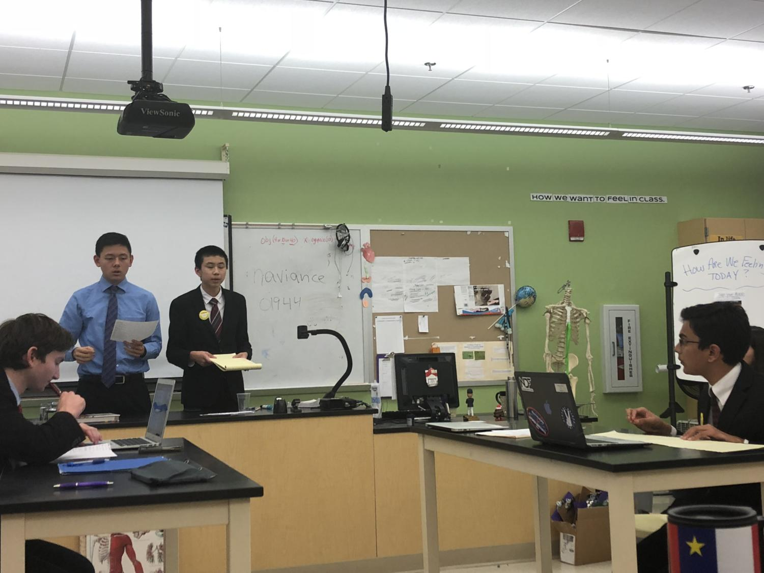"""Senior captain Andy Wang (second from right) and his sophomore partner Atharva Weling (right) debate against Lincoln-Sudbury juniors Jesse Sun and Brooks Howell. The two Wayland debaters acquired a silver bid to the Tournament of Champions at the Tim Averill Invitational in Manchester-Essex. """"I've done debate for four years and I was a failure for the first three, so now it feels good to have something under my belt,"""" Wang said."""