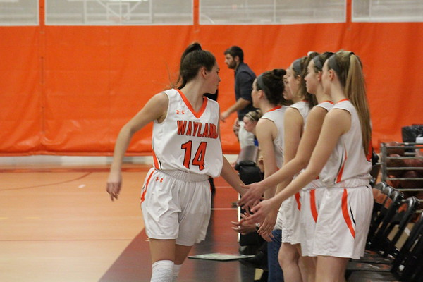 Freshman Sammy Johnson jogs off the court and high fives her teammates. Her teammates were very supportive of her work on the court.