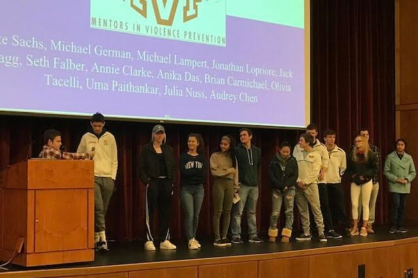 "Senior leaders in WHS's MVP (Mentors in Violence Prevention) club line up to introduce themselves before presenting. The MVP club gave a presentation to the Class of 2020 on Monday. ""I joined MVP because I liked the message of the club, [and] I thought it would be very helpful to help educate some of the juniors and [other] kids [who were] coming up through Wayland schools,"" senior Jake Sachs said."