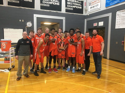 Boys basketball brings home holiday tournament trophy
