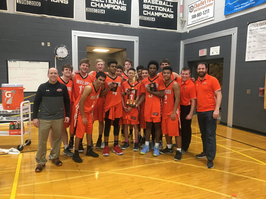 The+Wayland+boys+varsity+basketball+team+won+the+Barry+Hutchinson+Memorial+Holiday+tournament+at+Bellingham+High+School+on+Dec.+28+after+defeating+two+talented+teams.+%E2%80%9CUs+winning+was+a+big+wake-up+call+for+a+lot+of+other+schools+and+other+programs+because+they+didn%27t+expect+Wayland+to+win+anything%2C%22+sophomore+Jabari+Nurse+said.
