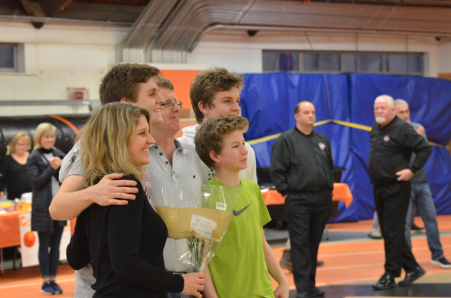 Senior+Myle+Larsen+stands+for+a+photo+with+his+family.+His+family+celebrates+with+him+for+Senior+Night.