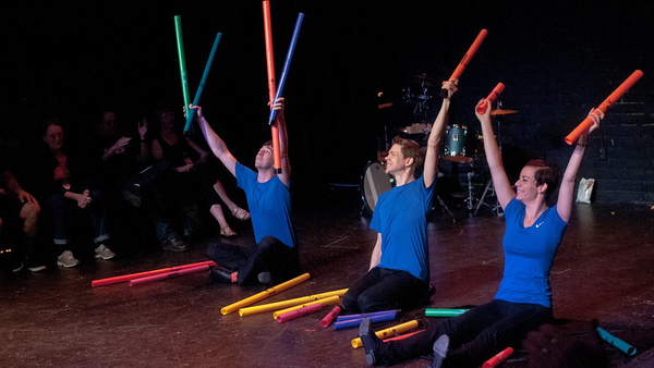 "The Fourth Wall Ensemble plays boomwhackers during a performance of their 'Fruit Flies like a Banana' program. The ensemble performed this hybrid show to WHS students on Thursday. ""[The] show is all about the nostalgia of childhood, something you don't have yet,"