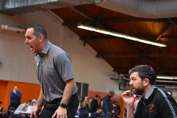 """Coaches Scott Parseghian (left) and Sean Chase (right) yell to Junior Cameron Jones at sectionals on Saturday Feb. 9. """"I mean, you do it to win, you do it for the relationships you build with the kids, but when you win it just makes it that much better."""" Parseghian said."""