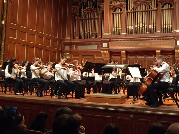 Freshman Alanna Xue as first chair playing with the Rivers Youth Orchestra Philharmonia at Jordan Hall. Xue has played the violin since age four and