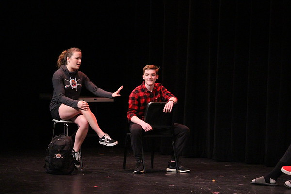 Seniors Clara Hurney and Eric McGonagle act as peer mentors for the freshmen class in a skit during the Senior Show. The show opened Friday, March 22 and attracted a full house of students and parents.