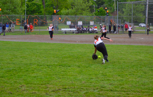 """Sophomore Abby Gavron dives for the ball on Senior Night. Gavron will be a captain of the softball team her sophomore year. """"I played center field a lot because the other captain is a catcher. Coach [Hipolito] Rivera taught me how to play catcher, and he really pushed me to be better. I am thankful for everything that he taught me because he helped me become the high school athlete that I want to be,"""" Gavron said."""