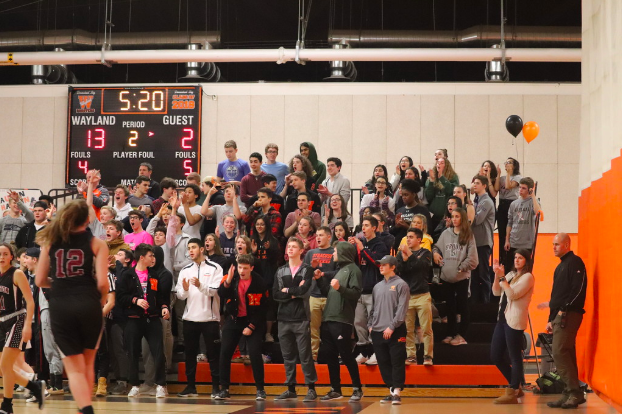 The+Wayland+fan+section+celebrates+during+the+girls+varsity+basketball+team%E2%80%99s+Coaches+vs.+Cancer+event+and+Senior+Night.+The+girls+won+50-29.+%22%5BMy+favorite+moment+was%5D+beating+Weston+on+our+Senior+Night+and+our+Coaches+vs.+Cancer+night%2C%22+head+coach+Amanda+Rukstalis+said.