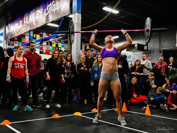 Sophomore Emma Gardner presses a barbell at a CrossFit competition. Gardner goes to CrossFit six days a week for four hours a day, and lives her lifestyle around CrossFit.