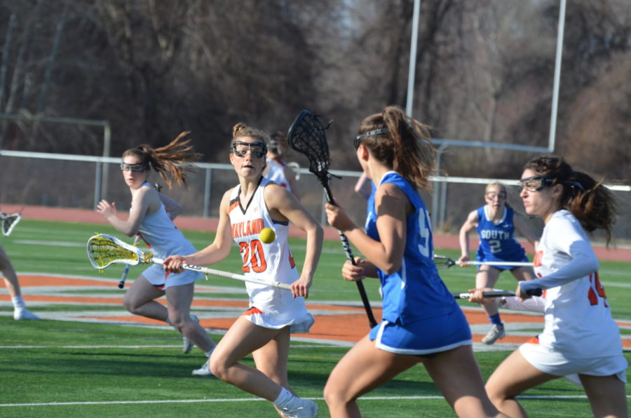 Protecting+Wayland%27s+defensive+half%2C+junior+Carly+Camphausen+pushes+a+Newton+South+defender+to+the+outside+of+the+field+as+she+makes+her+way+up.