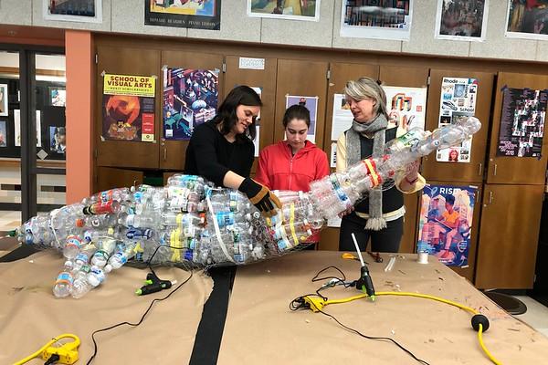 Art Teacher Veronica Latimer, junior Green Team member Rachel Tolmach, and English teacher Sara Snow construct the plastic whale