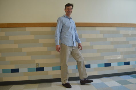 Business teacher Frederik Lehmann dresses in Banana Republic, L.L. Bean and Sock of the Month Club. Lehmann