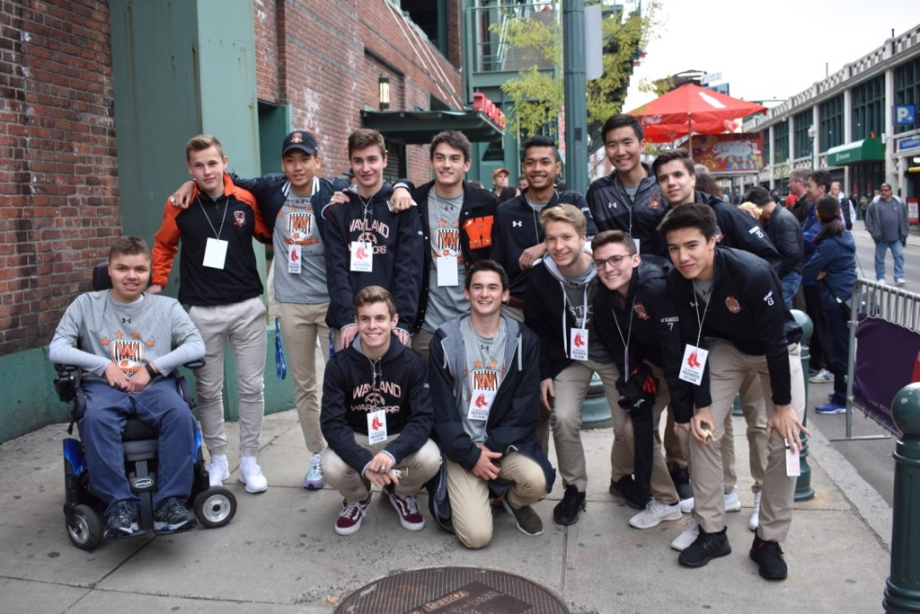 The+boys+soccer+team+get+together+so+Gavron+can+give+everyone+a+field+access+pass.+Every+state+champion+teams+are+honored+at+Fenway+on+the+park%27s+field.+