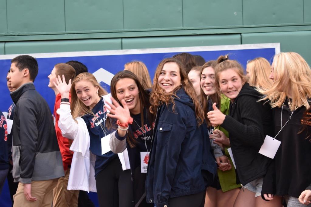 Senior+swim+captains+Rose+Kiefer%2C+Emma+Diianni%2C+Amanda+Armstrong+and+junior+Jane+Greenaway+wave+at+the+camera.
