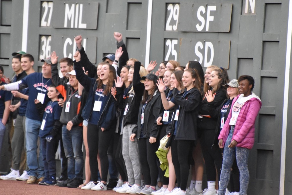 The+girls+swim+team+celebrates+their+State+Championship+as+they+are+presented+on+the+jumbotron+to+the+crowd.