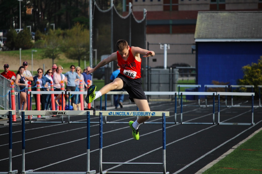 Junior+Collin+Hess+jumps+over+a+hurdle+doing+the+400m+hurdles.+