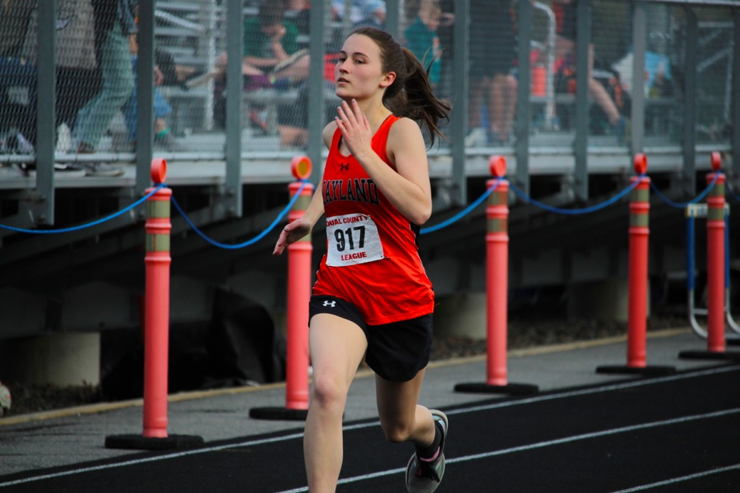Sophomore+Camryn+Lehr+moves+her+arms+and+legs+in+sync+as+she+strides+to+the+finish+line.