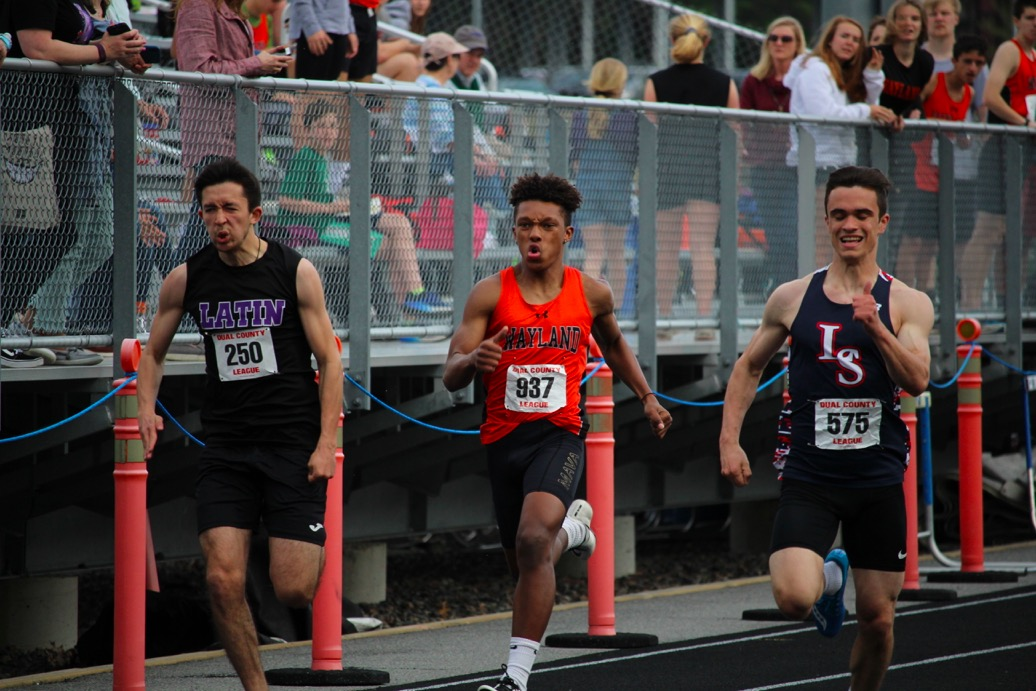 Sophomore+Raseed+Parham+shoots+down+the+track+while+racing+Boston+Latin+and+LS+athletes.+