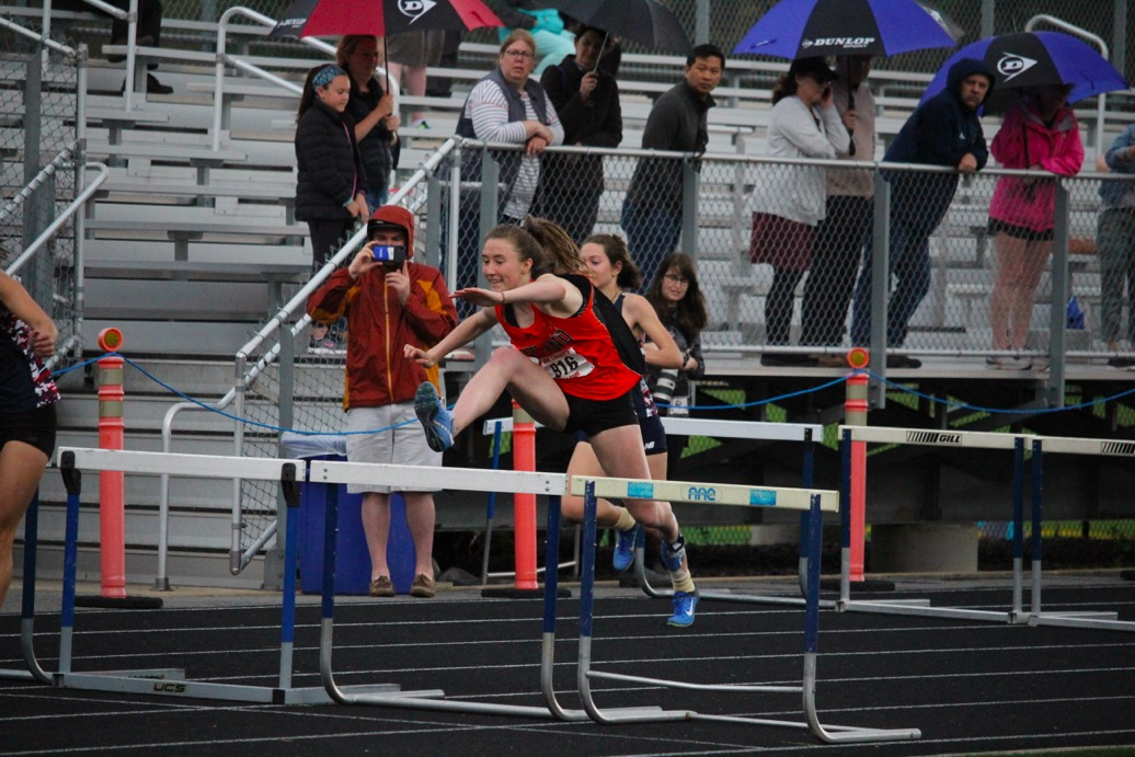 Senior+captain+Ella+LaClaire+jumps+one+of+her+last+hurdles+after+jumping+over+a+rouge+boys+hurdle+that+was+six+inches+higher+than+regulation.+