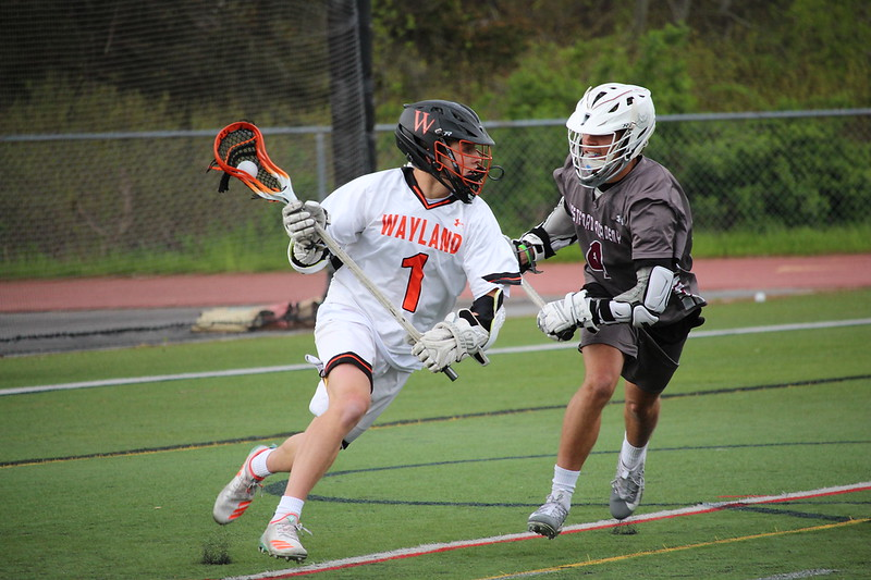Boys+varsity+lacrosse+captain+Michael+Lampert+cradles+the+ball+as+an+opposing+player+attempts+to+steal+the+ball.+He+runs+while+using+his+size+to+his+advantage%2C+looking+for+an+opening+to+throw+the+ball+for+a+play.+%E2%80%9CI+would+say+my+biggest+challenge+has+been+people+doubting+my+size%2C%E2%80%9D+Lampert+said.+%E2%80%9CI+have+overcome+this+by+doing+extra+workouts+to+show+people+that+I+can+use+my+size+to+my+advantage.%E2%80%9D%0A