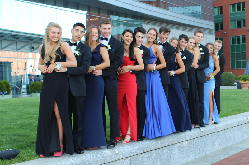 "Students of the Class of 2020 pose in front of the hotel with their dates. ""My favorite part about prom was getting dressed up and being with all my friends, being able to dance and just have a good time,"" Arden Knapp said. Knapp is a member of the Class of 2020 E-Board."