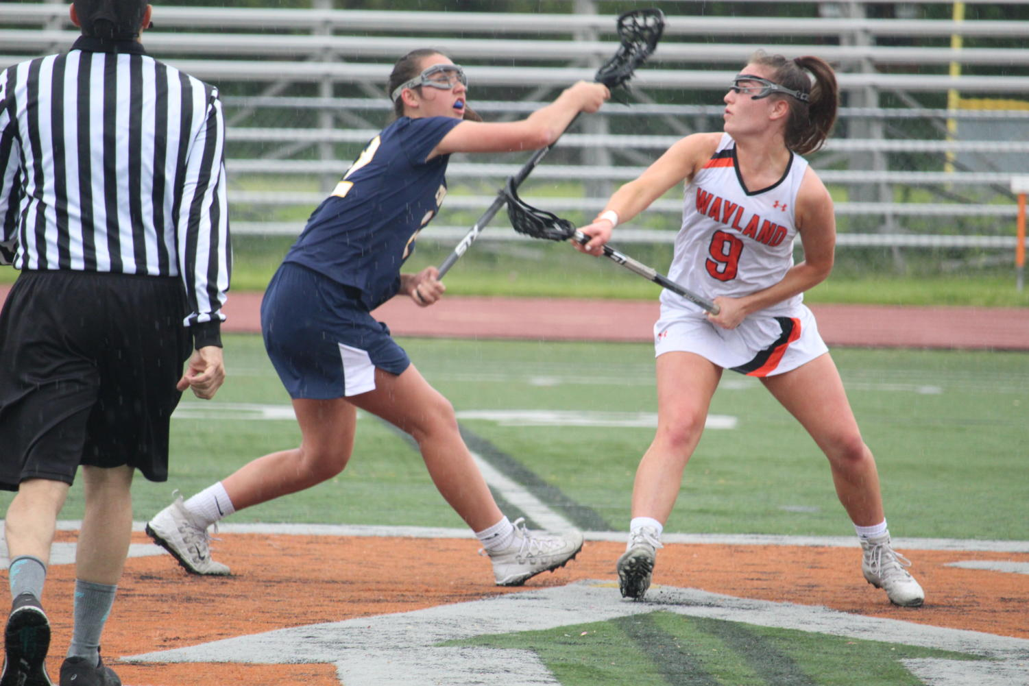 Senior+Kate+Balicki+squats+as+she+and+an+Acton-Boxborough+player+fight+for+the+ball+following+the+game+reset+after+Wayland%27s+goal.+