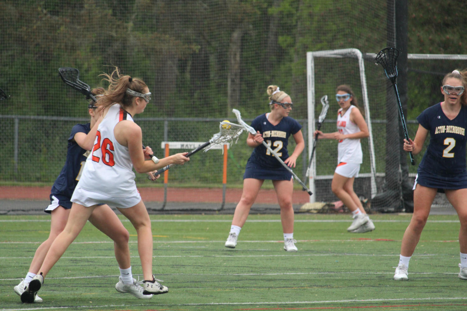 Senior+Lily+Tardif+fakes+to+the+right+to+evade+a+defender+as+she+rushes+to+the+net.