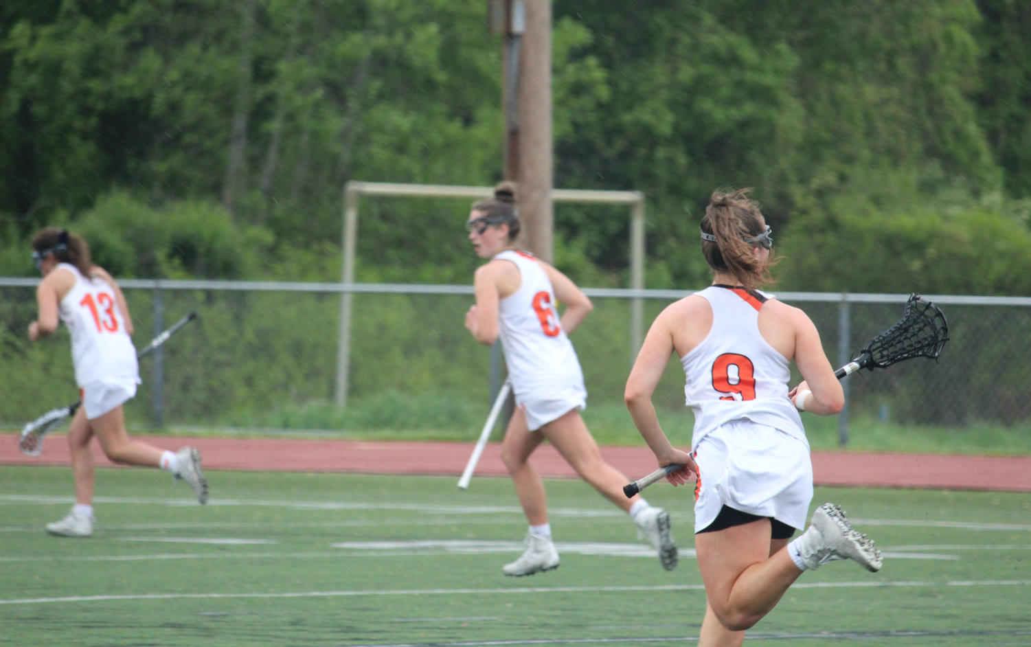 Balicki+rushes+down+the+field+to+help+their+team+mates+on+offense.