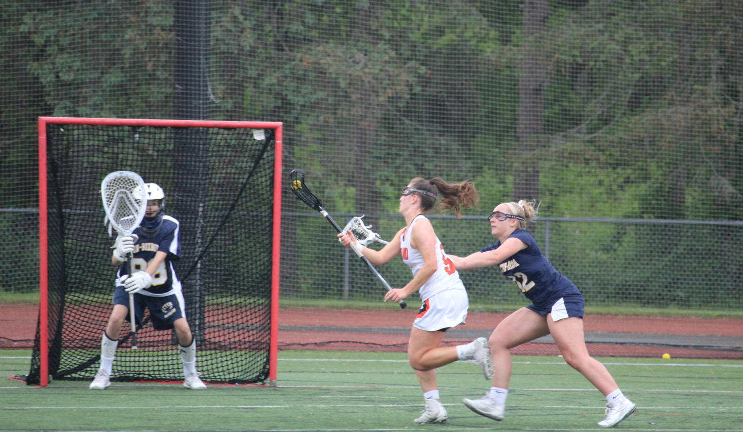 Balicki+charges+toward+the+net+with+Acton-Boxborough+close+behind.