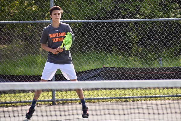 Sophomore+Noah+Lee+readies+himself+against+a+Bedford+opponent.+Coach+Shawn+Powers%27s+strategy+is+to+play+to+the+player%27s+strength%3A+Noah+Lee+thrives+in+a+singles+match.