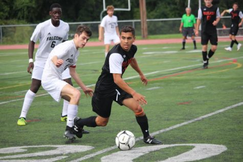 Photo+of+the+Week+Sept.+30%2C+2018%3A+Senior+Mateos+Norian+makes+a+move+to+protect+the+ball+in+the+boys+varsity+soccer+game+against+Cambridge+Rindge+and+Latin.