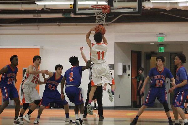 Photo of the Week Jan. 22, 2019: Sophomore Noah Lee takes a pull-up jump shot during the boys varsity basketball game against Newton South. The Warriors won the game with a final score of 65-64.
